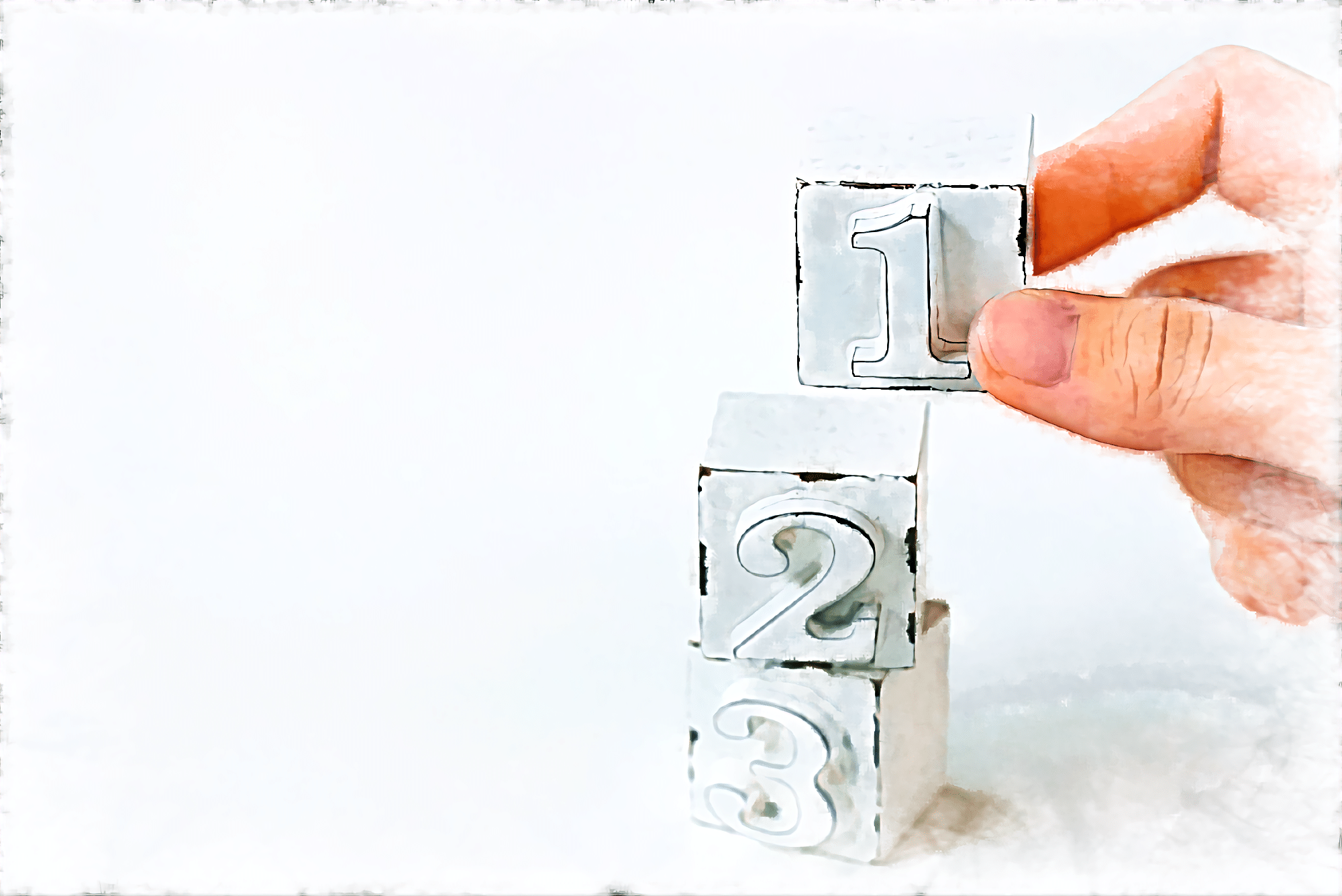 番号の書かれた積み木を持つ手